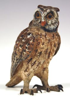 An early 20th Century cold painted bronze figure of a standing owl.
