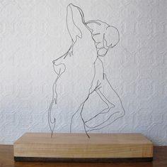 Van simpele ijzerdraadjes maakt kunstenaar Gavin Worth de prachtigste sculpturen