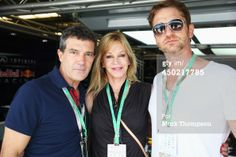 Actors Antonio Banderas, Melanie Griffiths and Gerard Butler are seen in the Infiniti Red Bull Racing garage before the start of United States Formula One Grand Prix at Circuit of The Americas on November 17, 2013 in Austin, United States. (Photo by Mark Thompson/Getty Images)