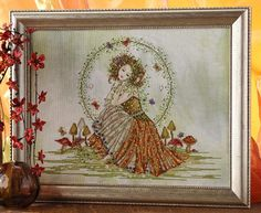 Check out Earth Goddess and more exclusive items at Robin's Nest Designs now. Cross stitch chart by Joan Elliott. Model was stitched on Nature's Grace Jobelan by Polstitches using Mill Hill Beads Kreinik Braids DMC Color Variations and DMC floss. Dragon Cross Stitch, Cross Stitch Angels, Cross Stitch Charts, Cross Stitch Designs, Cross Stitch Patterns, Mill Hill Beads, Earth Goddess, Cross Stitch Collection, Beautiful Fairies
