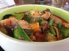 """Spicy red curry with rice field -cat fish or """"Kaeng Pa Pla Dook Na"""" in Thai."""