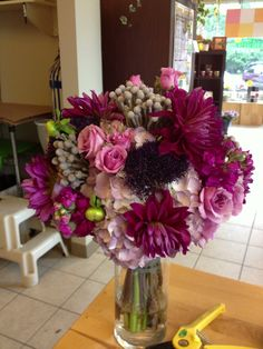 Mi Amore. Dahlias are so gorgeous in this bridal bouquet and the brunia berries add just the right amount of accent!  Www.bloomtasticweddings.com