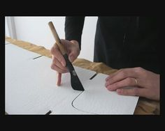 """Silvia Cordero Vega. Calligraphy on corrugated fiberboard  """"This video is about my last installation in Casa Foa - CMD 2011. I painted and made the letters on each module with Alba latex paintings. I used de modules designed by Pomada studio. The tool is a big ruling pen made by LUTHIS. """""""