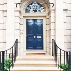 "Nothing is more grand than a stunning statement door. This gorgeous royal blue front door definitely gives an entrance that'll make all your guests say, ""Wow! Door Entryway, Entrance Doors, Foyer, Garage Doors, Front Doors, Grand Entrance, Door Design, Exterior Design, Interior And Exterior"