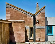 Image result for rammed earth and truss