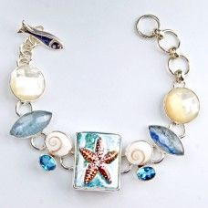 Starfish Bracelet with Ceramic Tile, Shiva Shell, Aquamarine, Blue Topaz, Mother Of Pearl handcrafted jewelry in .925 sterling silver.  Beach jewelry ready for summer designed by Chris Bales for Elligators Silver Jewelry