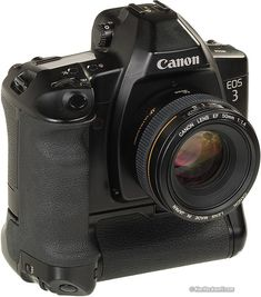 Canon EOS-3 Auto Focus Film SLR Camera. I think this is the Canon FIlm SLR I want...  (Ken Rockwell's reivew contains a link to ebay.)