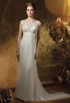 Brides: James Clifford Collection. Silk chiffon, hand-beaded embroidered lace and tulle soft A-line gown. Cap sleeves and illusion neckline with beaded trim. Illusion scoop back bodice with covered button closures. Soft skirt with chapel length train.