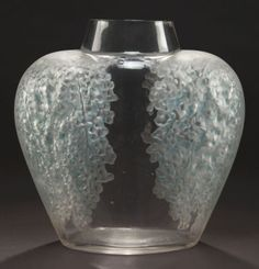 R. LALIQUE CLEAR GLASS POIVRE VASE WITH  GREEN PATINA  Circa 1921  Molded: R. LALIQUE  Engraved: France  9-1/2 inches high (24.1 cm)