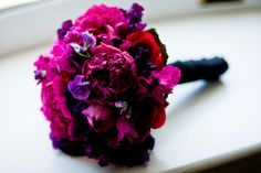 The bridesmaid bouquet.  Deep and dark magenta peonies, garden roses, sweet peas, cyclamen, lisianthus