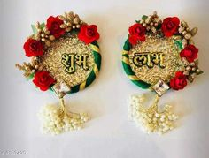 Religious Idols & Paintings Elite Shubh-Labh Hangings For Diwali Festival Material : Flowers  Size: 6 in Description: It Has 1 Sets Of Doors Shubh-Labh Hangings For Diwali Festival Work: Pom Pom & Beads Country of Origin: India Sizes Available: Free Size   Catalog Rating: ★3.9 (1307)  Catalog Name: Elite Trendy Shubh-Labh Hangings For Diwali Festival Vol 1 CatalogID_425486 C128-SC1316 Code: 491-3103429-113