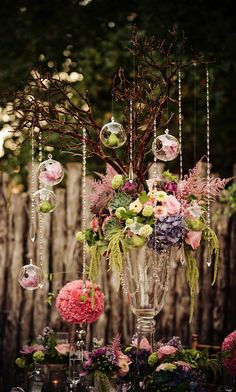 Make a stunning tablescape like this with our Blown Glass Globes, hanging crystals and beautiful flowers! #wedding #flowers #glam