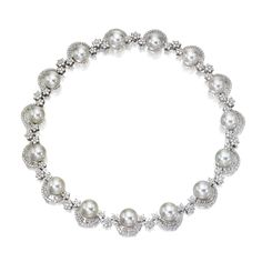 CULTURED PEARL AND DIAMOND NECKLACE Composed of 15 cultured pearls measuring approximately 13.9 to 12.7 mm., partially framed by rows of tapered baguette and round diamonds, connected by groups of floral clusters of round diamonds, the total diamond weight approximately 29.00 carats, mounted in 18 karat white gold