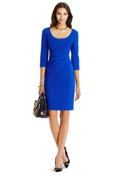 An essential work silhouette, the DVF Lillian features 3/4 sleeves, a wide scoop neck, and a touch of ruching that flatters the waist. With side zip. Falls to mid-thigh. Fits true to size.