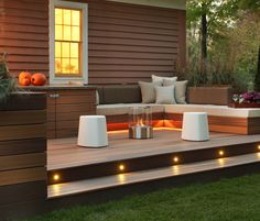 Wood accents like these - built in planters seats for the patio