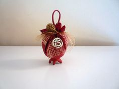2015 charm - dark red ceramic pomegranate with plastic leaves, dried flowers, net
