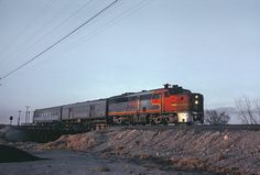 https://flic.kr/p/CcF8VS | The Pacos Valley Streamliner, Four Photos | Roger Puta photographed The Pacos Valley Streamliner, Train 25, at Roswell, NM on March 23, 1967. The lead unit was AT&SF PA-1 53L. Here crossing the Pecos River.