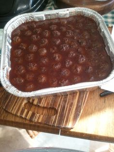 Grape jelly meatballs! I used 4bottles of heinz chili Sauce and 4 jars grape jelly. 3lbs (90% grade) ground beef    Sause-- combine chili sauce me grape jelly in stock pot. Heat until jelly becomes liquid. Then add meatballs    Meatballs---use 1 tsp measuring scoop.  Roll into small firm balls. Use only meat...no other ingredients necessary    Enjoy!