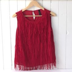 Festive Red Chiffon Tank Tank top in a festive red color perfect for the holidays. 100% Polyester. Worn once to a holiday Christmas party. Wish Tops