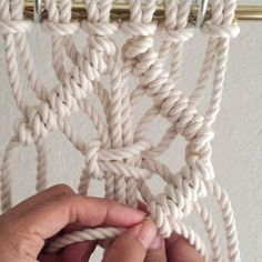 How to Tie a Square Knot inside a Clove Hitch Diamond // This video shows you how to tie one large square knot inside a Clove Hitch Diamond. It is decorative and used in Macrame wall hangings and Jewelry. // This video shows 6 cords at 5 feet each. Since folded in half and attached using the Larks Head Knot there are now 12 cords; 1-12 from left to right. For the sake of time, I tied one row of diagonal clove hitch knots using cords 1-6 and 7-12, which I'll explain how to do below…