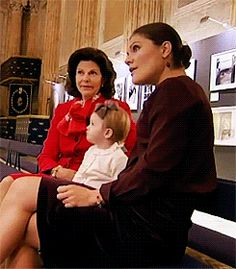 Queen Silvia with her daughter & granddaughter, future Queens, Crown Princess Victoria & Princess Estelle are discussing a painting of King Carl XVI Gustaf. ~~ Click the pic to see the pic set.