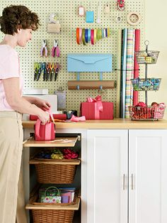 The countertop is a roomy, comfortable surface for wrapping, and the wall of pegboard above it puts all the supplies in one place. Easy Access Ribbon The wall is covered by a 4-x-8-foot sheet of pegboard which neatly displays the supplies. The ribbon unrolls easily when it's threaded onto picture wire wound around a pair of screws drilled through the pegboard and into the wall. Stash the Wraps An elastic band designed for pegboards holds rolls of wrapping paper. Ditch the Door Leaving the…