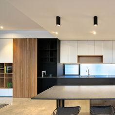 Our Titanium Surface Mounted Downlights rest seamlessly above the kitchen counter. The Titanium not only provides an efficient task light but creates a dynamic feature with its black texture in the midst of this open planned living space Downlights Kitchen, Interior Lighting, Lighting Design, Kitchen Island Lighting, Task Lighting, Counter, Living Spaces, Bedroom Decor, Surface