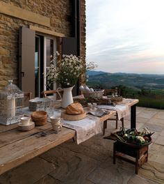 rustic outdoor dining table with incredible view on stone patio Outdoor Dining, Outdoor Spaces, Outdoor Decor, Outdoor Balcony, Rustic Outdoor, Pergola Patio, Outdoor Seating, Metal Pergola, Outdoor Sheds