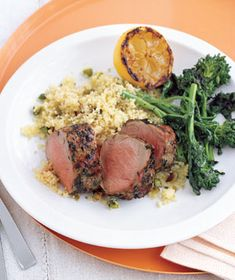 Grilled Pork and Broccoli Rabe With Couscous recipe from realsimple.com #myplate #protein #vegetables #grains