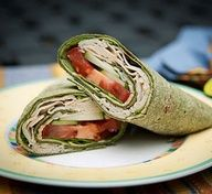 Cheesy Chicken Wrap:  1 spinach tortilla  1 Laughing Cow Sun Dried Tomato cheese wedge  Sliced deli meat (try Boars Head Cajun Chicken)  Tomato slices  Fresh spinach  Other veggies  Directions:  Spread LC cheese wedge on tortilla. Layer fresh spinach. On one end, layer deli meat with fresh veggies. Roll up starting with end with meat and veggies.