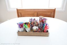 Tray with kids art supplies used as a table centerpiece - functional and colorful!