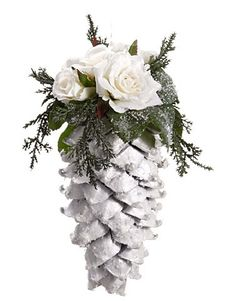 "From the Snow Drift Collection Item #XN0102-CR Features a glitter drenched large pine cone accented with white roses Fully dimensional ornament Comes ready-to-hang on a clear cord Dimensions: 9.5""H x"