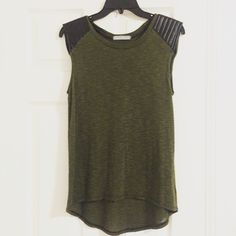 Army Green Top Army green top with black quilted shoulders. Comfortable and soft material. Longer in the back. Pristine condition Urban Outfitters Tops