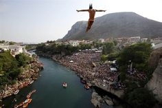 13. Competitors dive from the Old Mostar Bridge during the sixth stop of the Red Bull Cliff Diving World Series 2015, in Mostar on Aug. 15. Fourteen of the world's best competitors took part in the competition diving from the 88-foot high bridge over the river of Neretva.