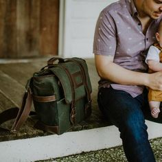 Dads, tired of carrying the girly diaper bag? Then, ditch it and get the Denver Waxed Canvas Diaper Bag. It's the only diaper bag that won't embarrass you. Dad Diaper Bag, Best Diaper Bag, Leather Handle, Cow Leather, Green Leather, Leather Bags, Best Gifts For Men, Gifts For Dad, Waxed Canvas Bag