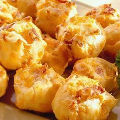 Bacon Cheddar Puffs - 1 cup milk, ¼ cup butter, 1 cup all-purpose flour, 4 large eggs, 1 cup Sargento Fine Shredded Sharp or Mild Cheddar Cheese, 8 slices bacon, cooked crisp, crumbled, ½ tsp.onion salt or powder, ¼ tsp garlic salt, ¼ tsp pepper.