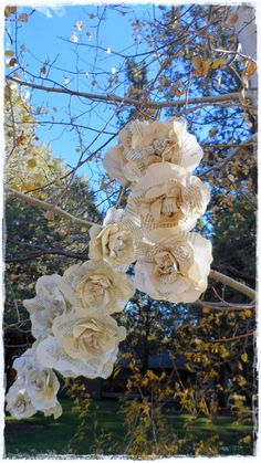 Love the larger blooms - maybe try with larger napkins and mix in with smaller napkin garlands. Concerned paper will be too heavy.   6 ft 18 Roses Swag Garland Paper Flowers Swag by LoveEmbellished, $28.00