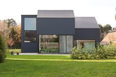 Our fibre cement Vertigo slates beautifully enveloping both the roof and facade. Build Your Own House, Slate Roof, Roof Tiles, Cement, Facade, Beautiful Homes, Mansions, House Styles, Building