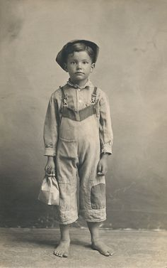 A child laborer off to work, lunch in hand? Or just studio props? The boy is identified as Willard Fan (or Tan).