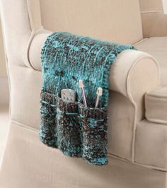 This DIY armchair caddy is a great way to keep all your remotes in one place for TV time. | living room storage | Free Knitting Pattern @joannstores