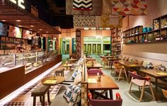 Bahrain Restaurant - This vibrant Bahrain restaurant mixes tradition and contemporary style inspired by street cafes. The fast casual dining concept contrasts heritage ...