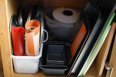 Pimp My Small Kitchen: 10 Cheap, Renter-Friendly Improvements - Bin for pot lids and silplat