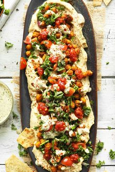 30-minute Chickpea Shawarma Dip with roasted chickpeas and parsley tomato salad. This delicious recipe is both vegan and gluten-free!