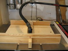 Homemade table saw crosscut sled featuring a dust collection port and dual runners. Table Saw Workbench, Table Saw Jigs, Woodworking Table Saw, Woodworking Courses, Woodworking Saws, Woodworking School, Learn Woodworking, Woodworking Workshop, Popular Woodworking