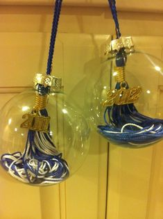 Great idea, never knew what to do with these...Graduation tassel ornaments.