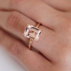 Emerald Cut AAA Morganite ring set into signature cow prongs. Solitaire style sitting atop a rounded band is definitively the center of attention. This ring will definitively turn heads. Side of band width, Emerald Cut Sapphire Ring, Emerald Cut Rings, Dream Engagement Rings, Rose Gold Engagement, Alternative Bride, Morganite Ring, Dream Ring, Wedding Rings, Stud Earrings