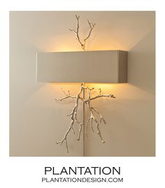 Branches Wall Sconce | NickelEnliven an entryway with the chic look of this modern-meets-organic wall sconce. Shimmering metallic branches are expertly crafted of nickel, topped by a sleek rectangular shade. Hangs on two keyholes. 2-40W candelabra bulbs. Choose plug-in with cord cover or hardwired.