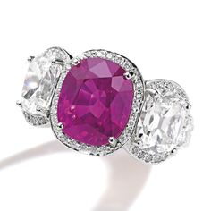 Platinum, Pink Sapphire and Diamond Ring, Oscar Heyman & Brothers. Centering a 10.05 carat cushion-cut pink sapphire, flanked by two cushion-cut diamonds weighing 6.02 carats, further set with round diamonds weighing 2.50 carats.