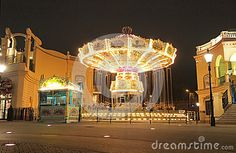 An old merry-go-round at night in Prater. Wiener Prater is a large public park in Vienna's 2 nd district