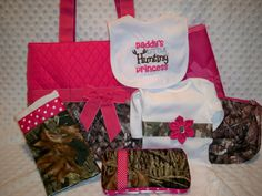 PERSONALIZED Camo & Hot Pink 7 Piece Baby Girl Gift Set Includes Diaper Bag, Changing Pad, Onesie, Burp Cloth, Wipe Case, Pouch, and Bib. $75.00, via Etsy.